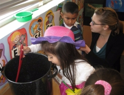 Children and research assistant engaging in dramatic play
