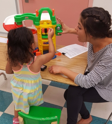 Research assistant gathering a play-based language sample