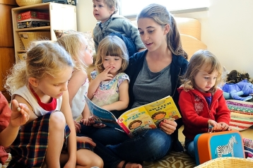 Research assistant engages children in literacy